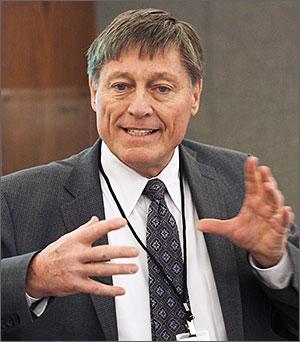 Wharton School lecturer and long-term care expert John Whitman at the podium.