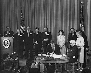 President Lydon B. Johnson signing the Medicare/Medicaid programs into law in 1965.