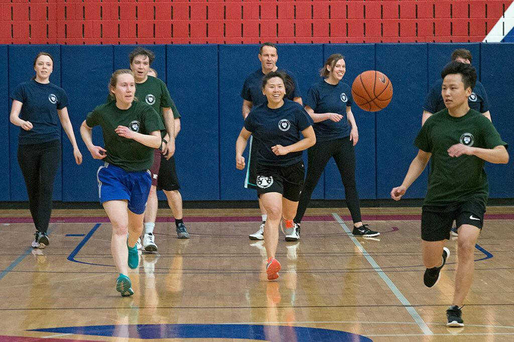 Chasing a rebound down the basketball court are Ashley Swanson, Amy Bond, David Abrams, Guy David, Vicki Chen, Sarah Dykstra, and Jong Lim