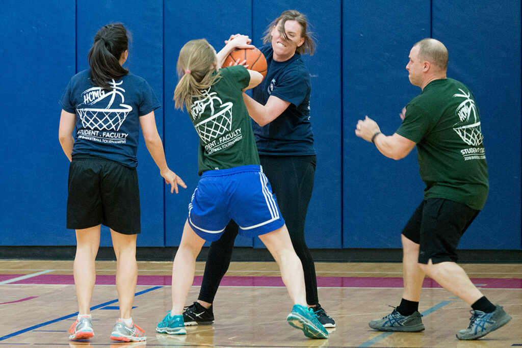 Giving no quarter, PhD students Amy Bond and Sarah Dykstra struggle for the basketball