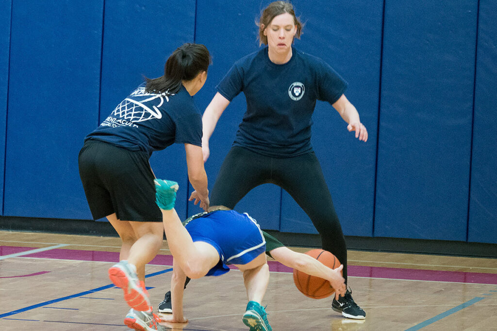 Wharton PhD student Amy Bond goes to the floor in the student-faculty basketball game