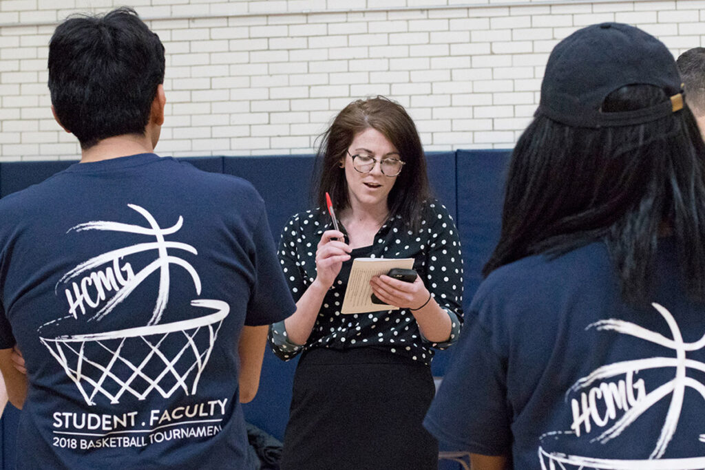 Postdoctoral Fellow and Blue Team coach Molly Candon reviews strategies during half time of the Wharton 2018 Student-Faculty basketball game