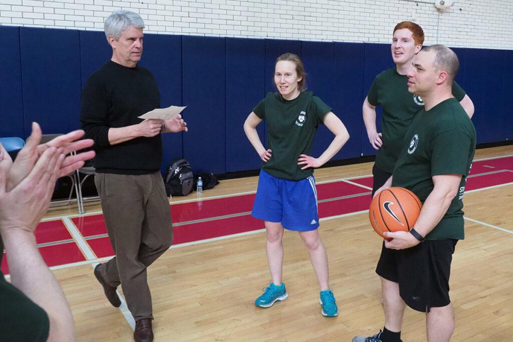 Green team coach at the 2018 Wharton basketball game is Wharton Professor Scott Harrington