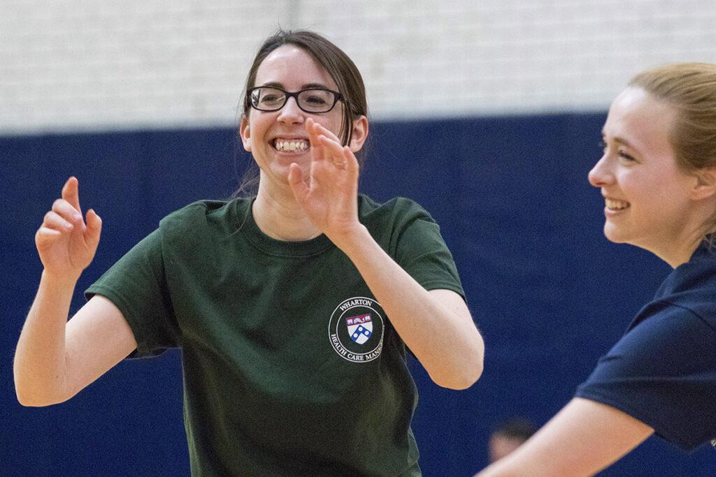 Assistant Wharton Professor Abby Alpert cheers on her teammates