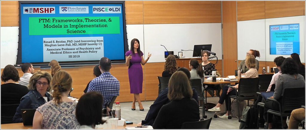 Director of the Penn Implementation Science Center Rinad Beidas, PhD, teaching an implementation science classroom group.