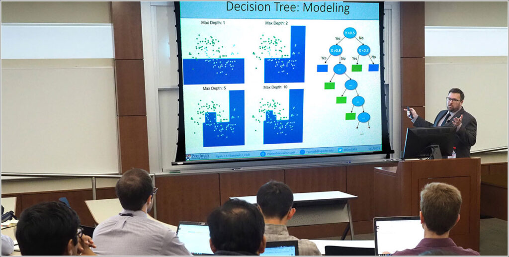 Ryan Urbanowicz conducts a machine learning class for health researcher faculty members at Penn