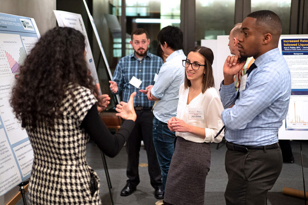 Young researchers discuss their work at the 2019 Population Health Science Research Workshop