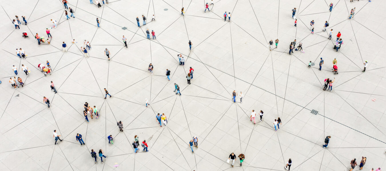 Aerial view of people walking connected by lines.