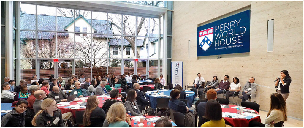 Inside a plenary session of the 7th Annual Penn Health Policy Retreat in Penn's Perry World House. Paula Chatterjee, MD, is at the podium.