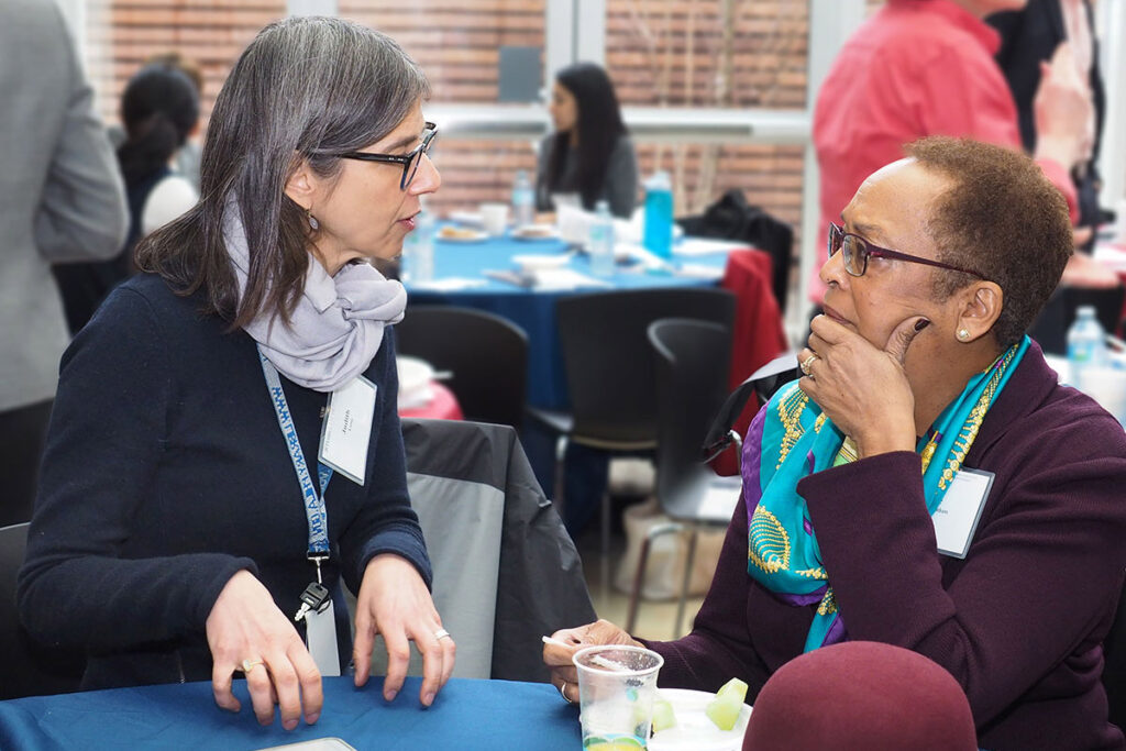Judith Long, MD, Chief of the Penn Medicine Division of General Internal Medicine chats with Eve Higginbotham, MD, SM, Vice Dean for Diversity and Inclusion at the Perelman School.