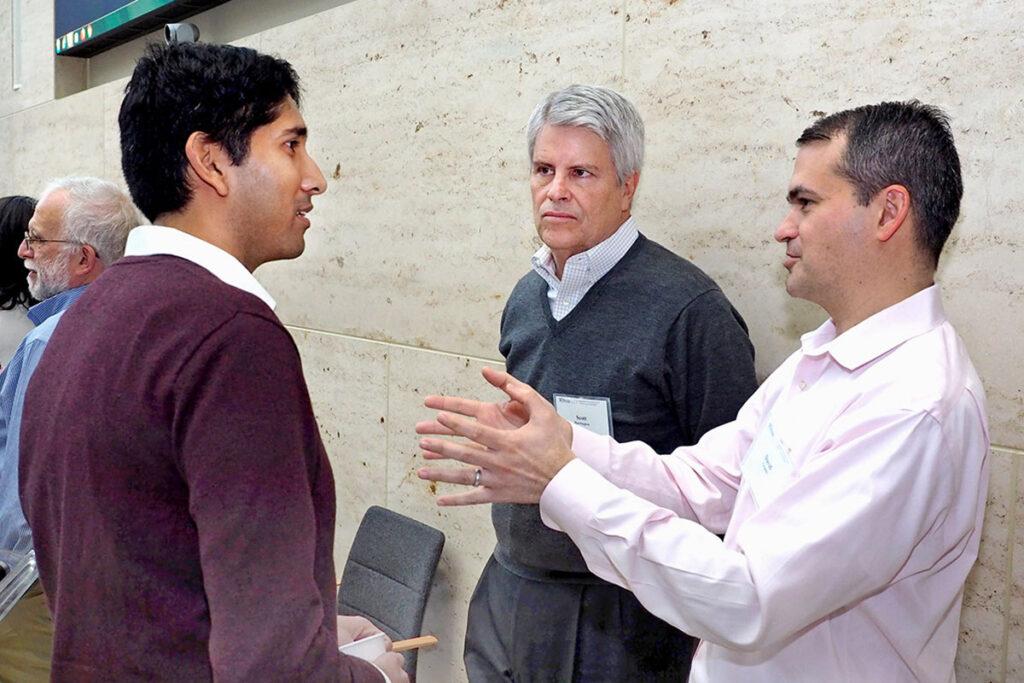 Atul Gupta, PhD, Scott Harrington, PhD, and David Grande, MD, MPA at a scientific conference