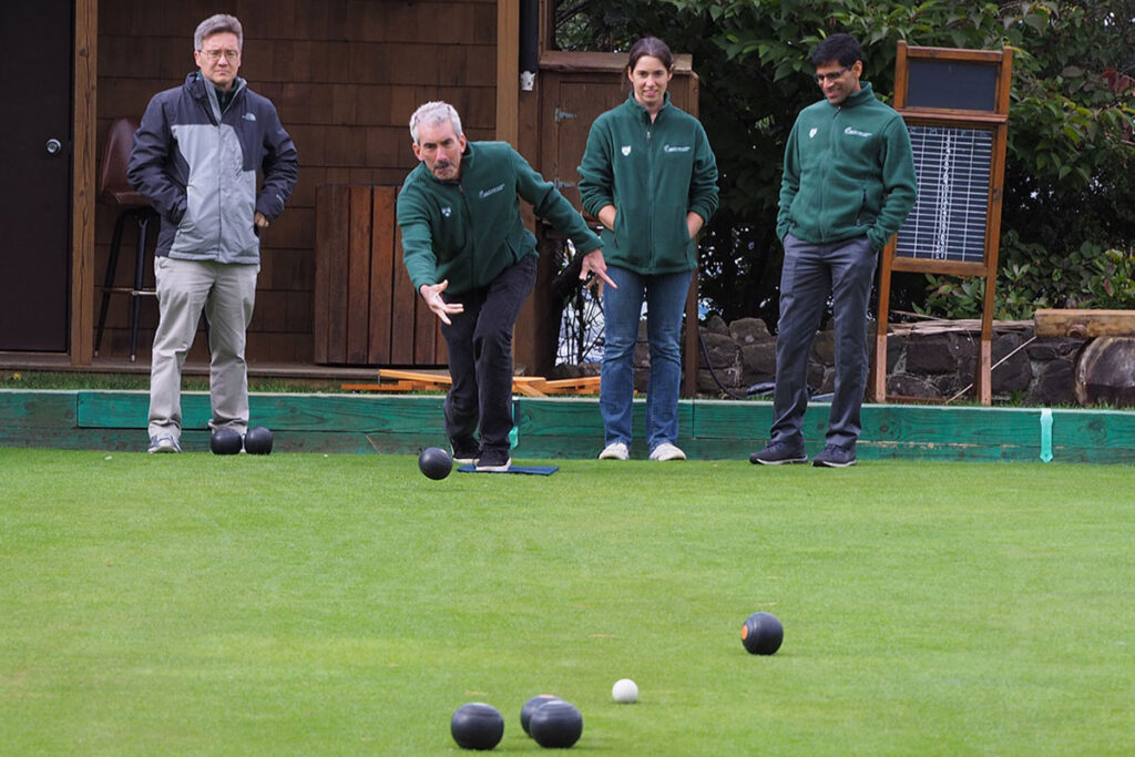 George Loewenstein, Kevin Volpp, Kristin Underhill, and Harsha Thirumurthy, PhD, engaged in a game of lawn bowling at a scientific conference