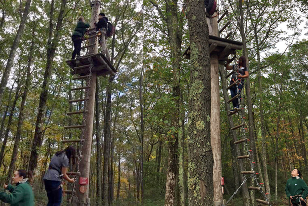 On a break, attendees at the 2018 Penn/CMU Roybal Behavioral Economics Retreat zoom down the new Skytop Lodge zip line.