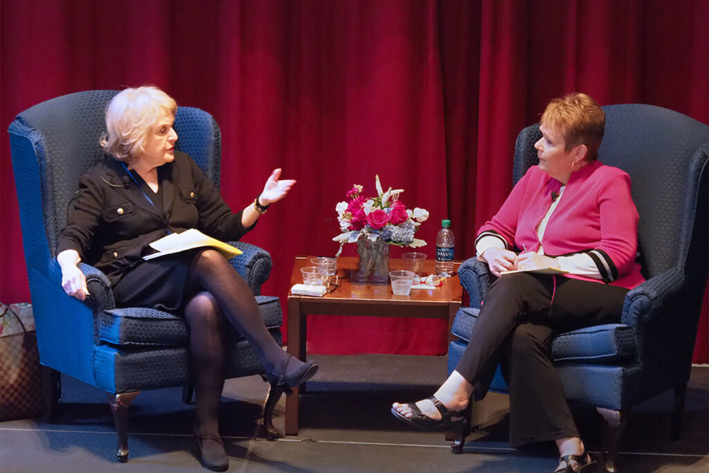 speaker Regina Herzlinger, DBA, a Professor of Business Administration at the Harvard Business School being interviewed by Jackie Judd, a Health Policy Communications Consultant