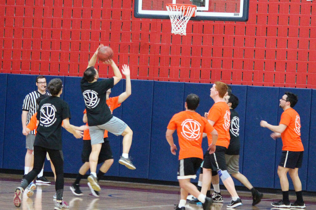 Daniel Polsky scores a basket on the basketball court